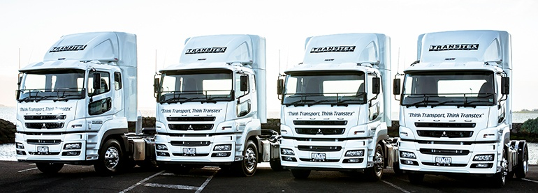 Transtex Transport Stormtrooper inspired Fuso Heavies in a row