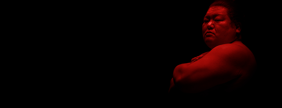 Sumo in red lighting on black background